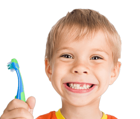 Smiling boy holding a toothbrush
